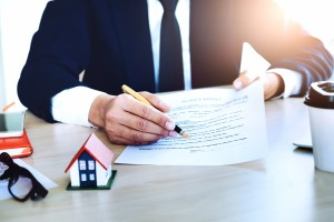 agreement paper,estate agent gives pen and documents agreement with customer to sign contract for . Concept insurance