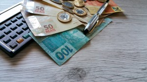 Money from Brazil. Notes of Real, Brazilian currency. Calculator.Concept of economy