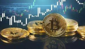 Bitcoins and New Virtual money concept.Gold bitcoins with Candle